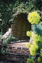 Entrance to woven cedar tunnel
