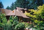 Looking up at Salt Spring home with luxuriant plantings designed for year round interest these plantings have been created within a glacial rock outcropping
