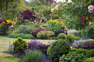 Claire Takacs image of Canadian Gardening number one residental garden for Canada. Layered Northwest perennial, shrub planting designed for year round interest. - Victorian Garden Tours